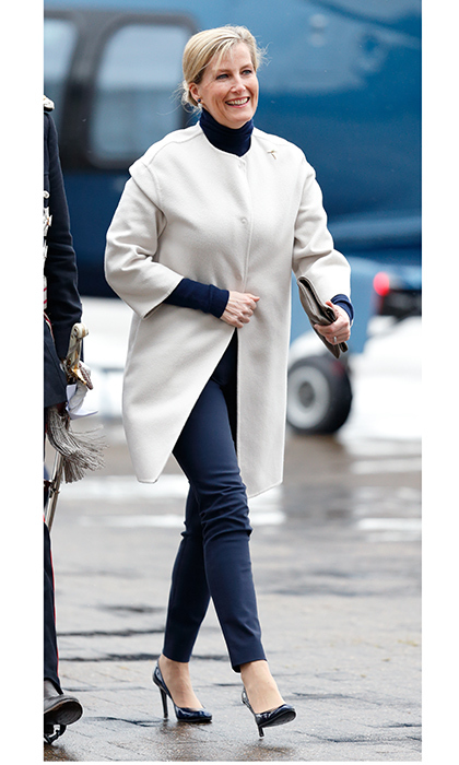 Sophie, Countess Of Wessex wore skinny pants and heels for her rain-soaked visit to the Orbis Flying Eye Hospital at Stansted Airport in London. 