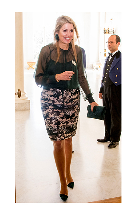 "Queen Maxima looked elegant wearing a sheer blouse and printed high-waisted skirt to open the symposium ""Tomorrow More Music in the Classroom"" held at the Noordeinde Palace.