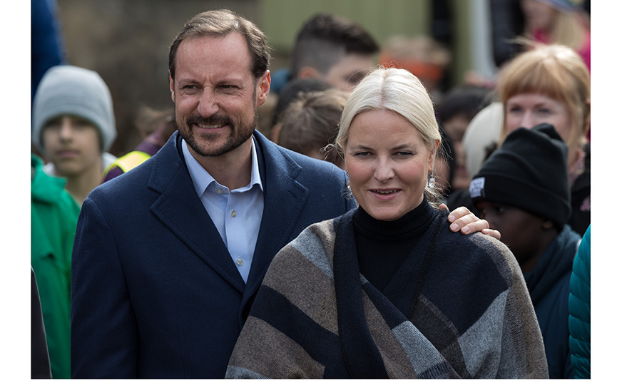 Crown Prince Haakon of Norway put his arm around wife Crown Princess Mette-Marit as they visited the Ice Lake forest in Oslo on March 27.