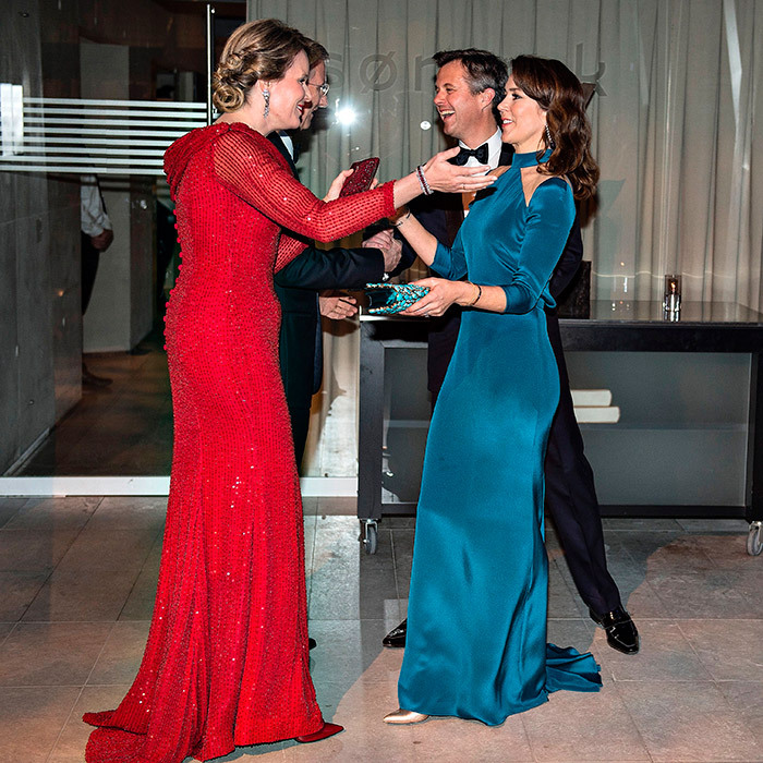 Fancy meeting you here! Queen Mathilde of Belgium, left, and Crown Princess Mary of Denmark, right, said hello at a reception in Copenhagen on March 29.