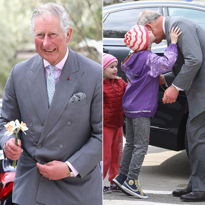 Say it with flowers – and a kiss! Prince Charles got a surprise smooch from Antonia Paduraru as he arrived at the FARA Foundation in Bucharest, Romania. Little sister Amalia was there for the adorable greeting, too. 