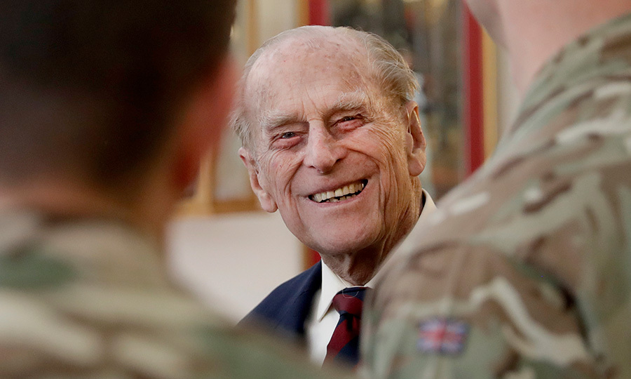 Queen Elizabeth's 95-year-old husband Prince Philip was all smiles as he met with officers from the 1st Battalion Grenadier Guards in his capacity as Colonel in Aldershot, England on March 30.