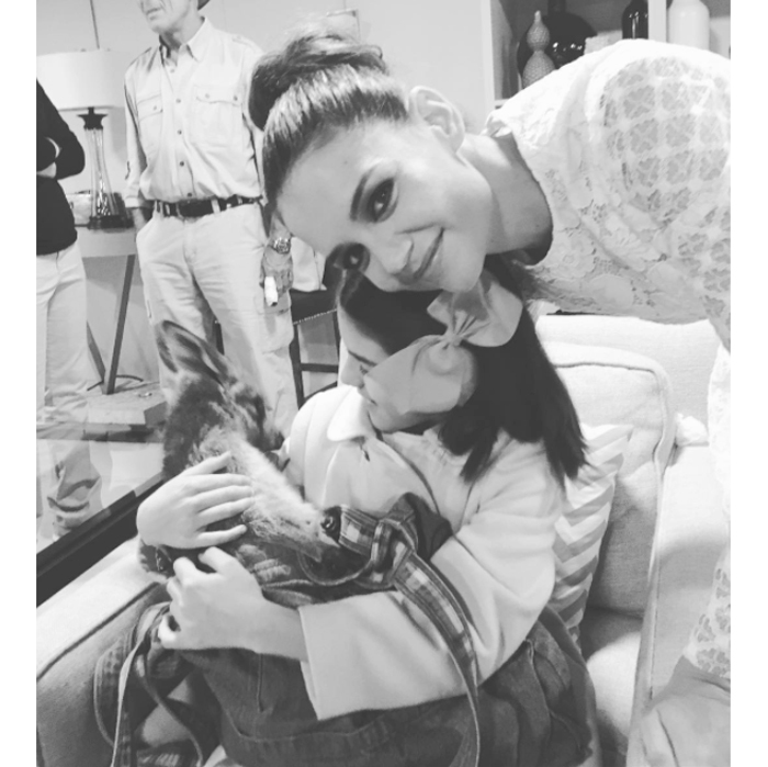 Katie Holmes' daughter Suri Cruise has made a furry new friend! The youngster was seen cuddling up to a baby kangaroo, in a photo posted on Instagram by her proud mom. The ten-year-old was the picture of happiness while backstage at <i>Good Morning America</i>, cradling the joey in her arms and beaming down at the animal while Katie posed behind her daughter. Photo: Instagram/@katieholmes212