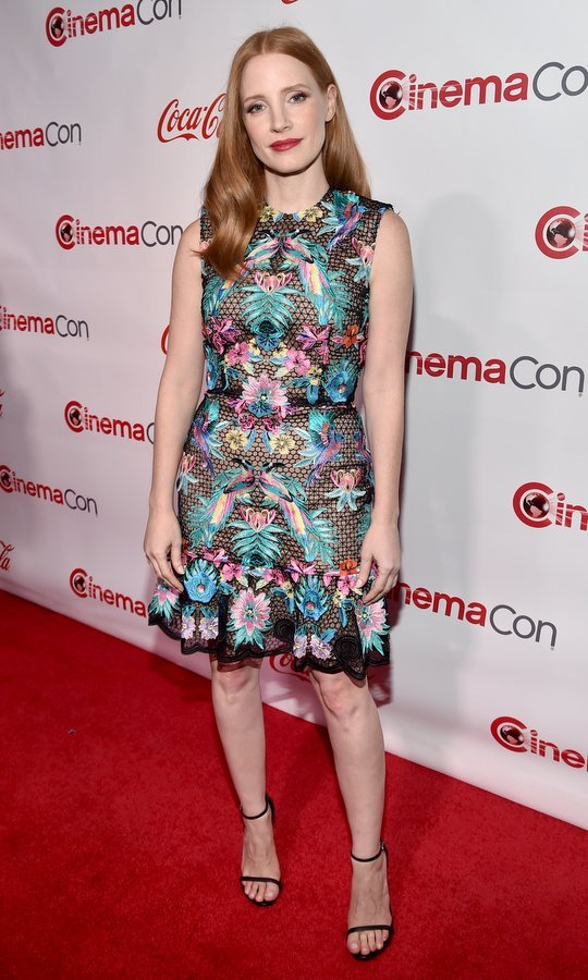 March 30: Jessica Chastain wore a bright bloom print for the CinemaCon Big Screen Achievement Awards brought to you by the Coca-Cola Company at Omnia Nightclub at Caesars Palace during CinemaCon.