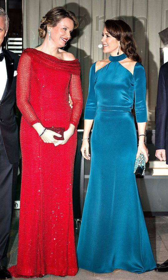 Crown Princess Mary of Denmark, right, and Queen Mathilde of Belgium, left, both wore bright figure-skimming gowns for a black tie gala in Copenhagen on March 29.