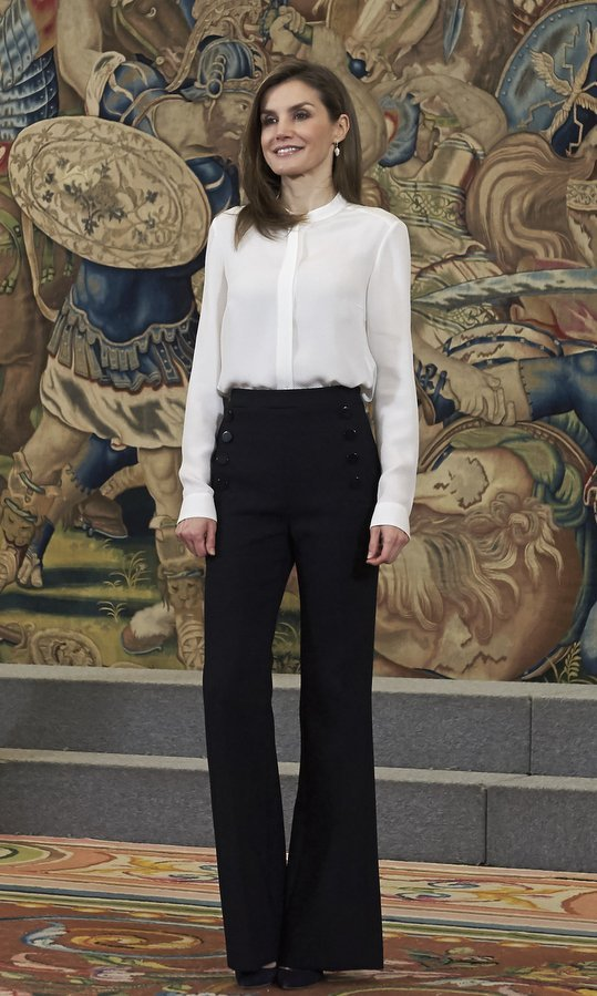 Queen Letizia of Spain showed that keeping it simple is always chic in flared trousers and a white blouse at Zarzuela Palace on March 28.