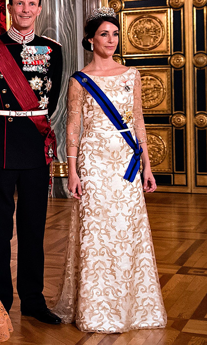 Princess Marie of Denmark's gown for the state dinner in Copenhagen had an embroidered lace overlay which complimented her stunning tiara.