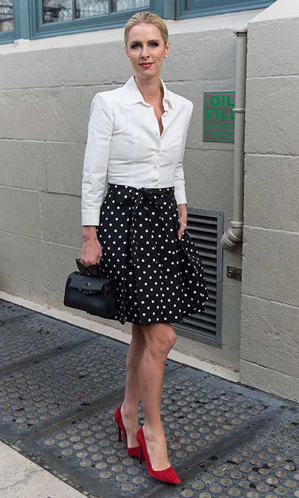 Pretty in polka dots! Nicky added a pop of color with red heels and lips to check out the Carolina Herrera Collection during New York Fashion Week in February 2017.