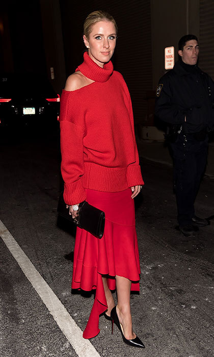 Lady in red! Nicky arrived at the Oscar de la Renta fashion show wearing luxurious knits during New York Fashion Week on February 2017. 