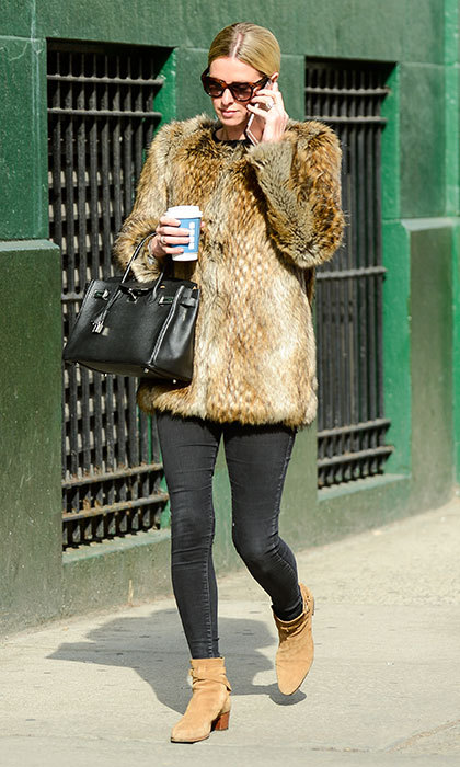 On a crisp but sunny day, the fashion designer combined a fur coat with dark sunglasses while on-the-go in January 2017.