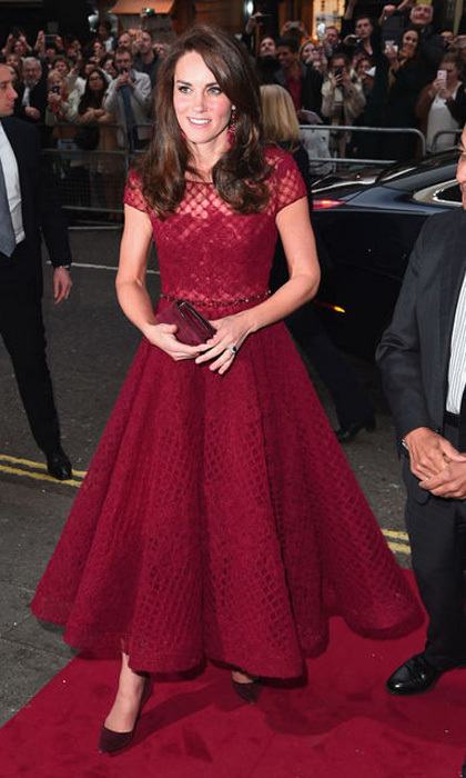 Kate may have added a new designer to her already impressive wardrobe with this pretty Marchesa Notte creation, but she relied on one of her favorite colors for her evening out. In April 2017, the Duchess wore this crimson tea length gown to the opening night of <i>42nd Street</i> in London that benefited East Anglia Children's Hospice.