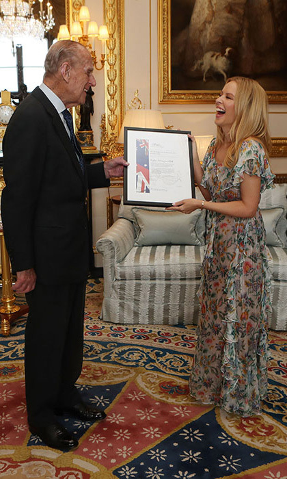 Prince Philip and Kylie Minogue shared a laugh together during the singer's recent visit to Windsor Castle on April 4, 2017, where she was presented with the Britain-Australia Society Award for 2016. The pair were in high spirits  during the private audience, which was held in the White Drawing Room. The Britain-Australia Society, for which the Duke has been Patron since 1970, aims to bring together people to advance the relationship between the two countries – be it through commerce, public service, education, sport, entertainment or culture.