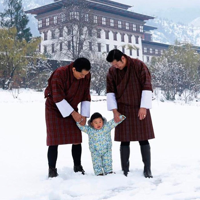 "Snow baby! The Dragon King celebrated the month of April by sharing a photo of himself enjoying the ""unexpected March snowfall"" with his son Prince Gyalsey and father Jigme Singye Wangchuck at the Lingkana Palace.