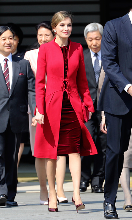 April 5: <b>Queen Letizia of Spain</b> mixed crimson hues at a ceremony in Tokyo – a bright red Felipe Varela coat worn with a burgundy velvet dress and matching heels. 