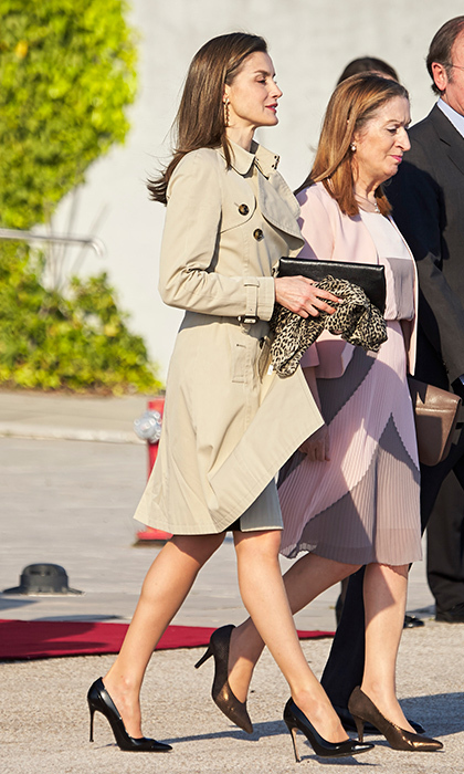 April 3: <b>Queen Letizia of Spain</b> kept airport style simple with a classic trench coat and black heels as she headed to Japan. 