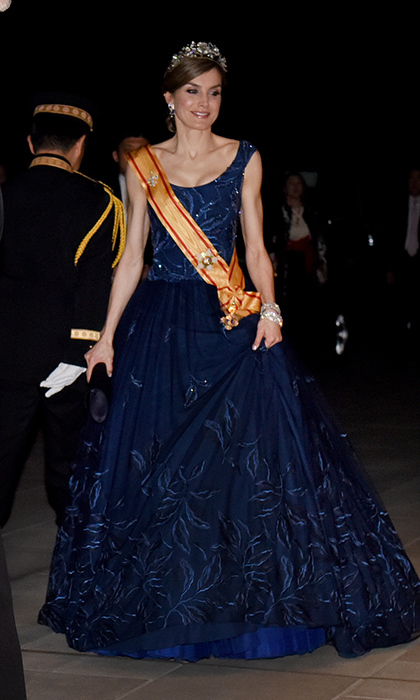 April 5: King Felipe's wife arrived at the Imperial Palace in Tokyo for the state banquet looking straight out of a Disney fairytale in a dark blue embroidered gown and gold sash. 