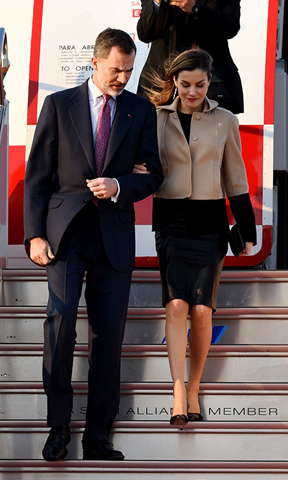 April 4: <b>King Felipe VI of Spain</b> and wife <b>Queen Letizia</b> arrived at Haneda Airport in Tokyo for their four-day state visit to Japan. Letizia wore a black dress under a camel and black color-block coat.