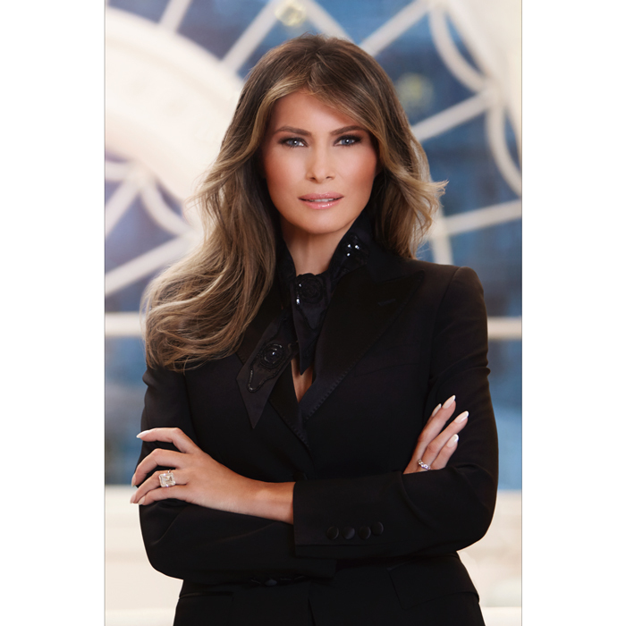 Melania channeled her inner New Yorker wearing all-black for her first official portrait as First Lady of the United States. President Trump's wife looked ultra glam in the White House photo wearing a Dolce & Gabbana turlington jacket and a silk sequin Hermes scarf, while styling her brunette tresses with her signature blowout.