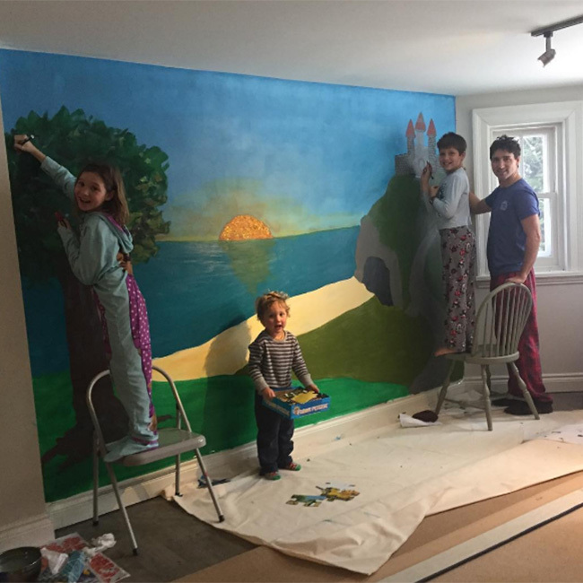 """Prime minister and a painter! Justin Trudeau, in his sweats, helped his and Sophie's three children Xavier, nine, Ella-Grace, eight, and three-year-old Hadrien paint a mural that featured a castle in their home. Sophie showed off their work on Instagram writing, """"What did we do after staring at the beige basement walls on a rainy day? A mural!!!! Nothing better than art and colours to wake up our spirits. A vos pinceaux les enfants!"""" Photo: Instagram/@sophiegregoiretrudeau"""