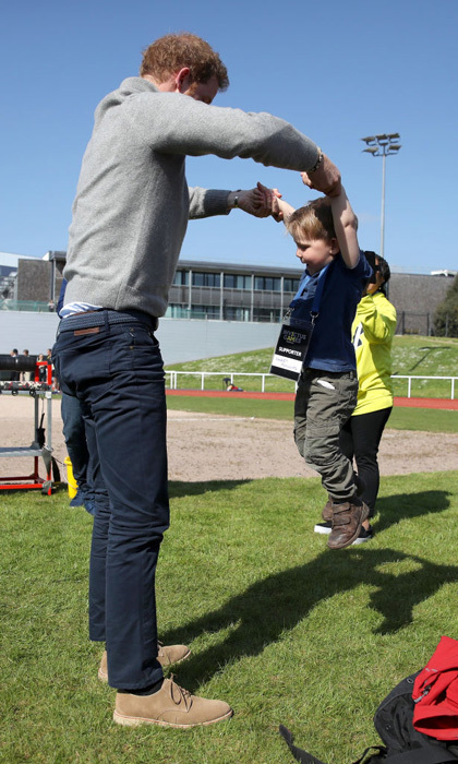 During the UK team's Invictus Games trials at University of Bath, Prince Harry found a little competitor in two-and-a-half year old Harry Phillips. The Harrys had some fun boxing and roughing it.