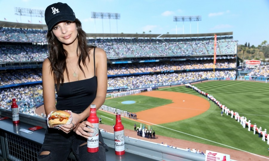April 3: Emily Ratajkowski celebrated opening day with a bite! The star was on hand for the launch of Bud & Burgers and The Official Burger of the LA Dodgers by Budweiser in the Budweiser VIP Suite at Dodger Stadium in L.A.