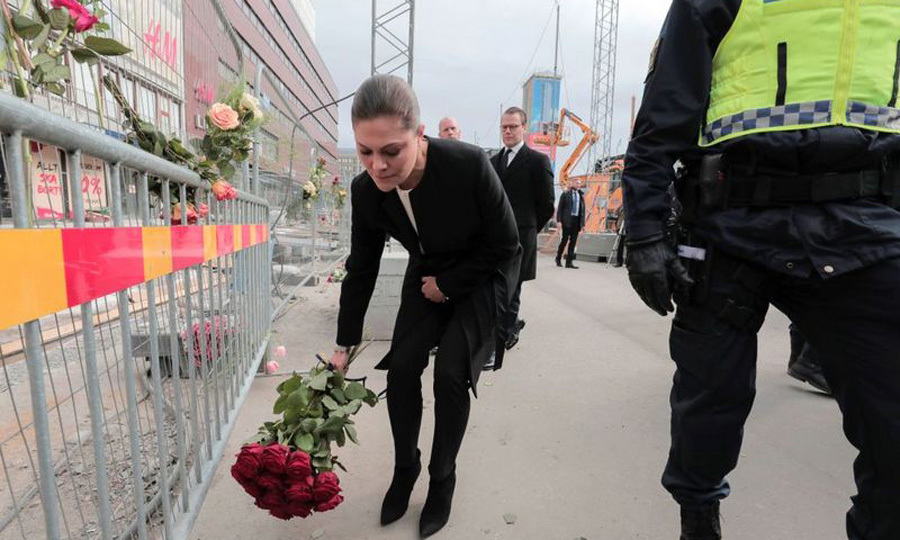 Crown Princess Victoria was overcome with emotion as she and Prince Daniel visited the site of Friday's suspected terror attack in Stockholm. The Swedish heir to the throne places roses at the scene where four people were killed. 