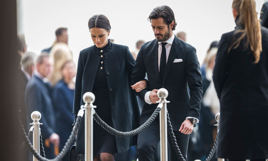 Prince Carl Philip escorted his pregnant wife Princess Sofia to Monday's memorial service honoring the victims of Friday's attack in Stockholm. This outing comes two days after Crown Princess Victoria visited the scene of the crime.