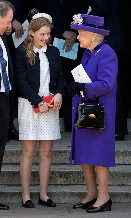 April 7: Queen Elizabeth showed she's a fan of regal purple as she chatted with great-niece Lady Margarita Armstrong-Jones, who served as flowergirl for Prince William and Duchess Kate's wedding, at Westminster Abbey. The 14-year-old royal looked very ladylike herself in an eyelet lace dress and flats.