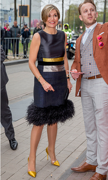 April 7: Wearing a feather-trimmed dress and yellow heels, Queen Maxima of the Netherlands was a study in color block accessorizing as she opened StudyPortals headquarters in Eindhoven.