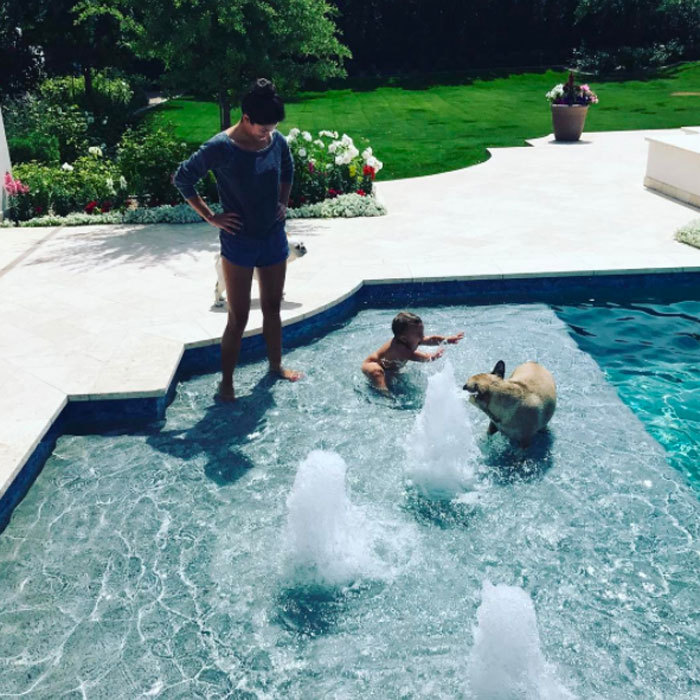 "Boomer Phelps was a little fish in the pool as his mom Nicole looked on. The photo that shows him loving the water was captioned, ""Pool time!!!! Working on my butterfly!!""