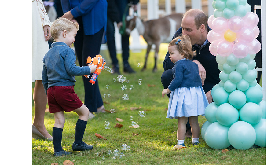 Bubble fight! With his little sister looking intrigued, Prince George looked like he was having a ball with his Finding Nemo bubble gun.