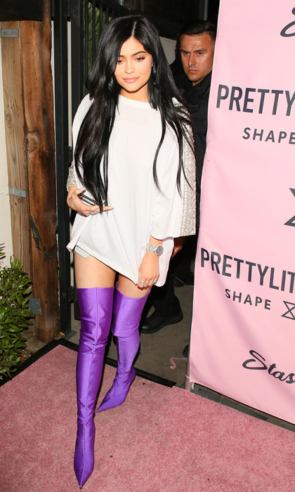 April 11: Kylie Jenner felt that purple rain with some thigh high boots during the Pretty Little Thing's new shape collection PLT Shape at The Phoenix in L.A.