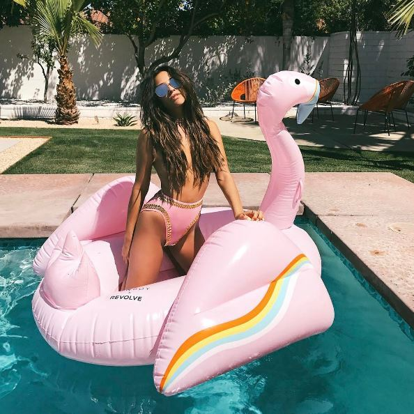 April 14: Shay Mitchell had some fun on a FUNBOY Flamingo float during the Revolve party in Palm Springs, California.