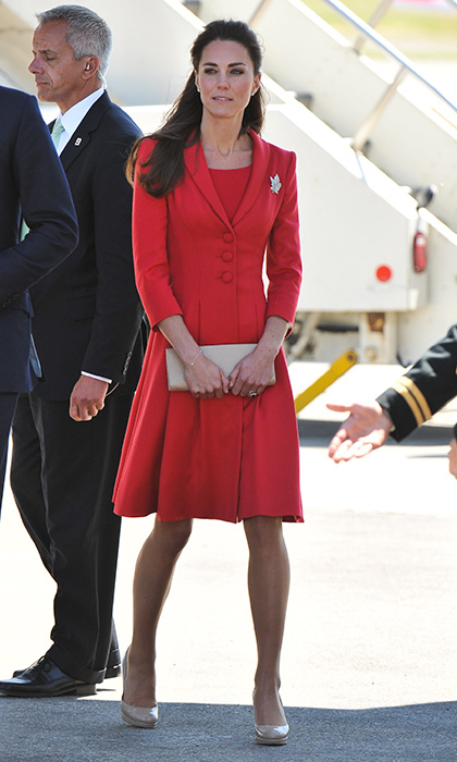 Regal in red Catherine Walker for an arrival at Calgary International Airport in Canada on July 8, 2011.