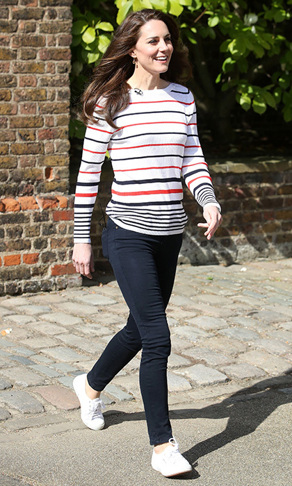 In April 2017, the Duchess hosted a special Heads Together reception for London marathon runners at Kensington Palace in a striped sweater by Luisa Spagnoli and white Superga sneakers teamed with her much-loved skinny jeans.