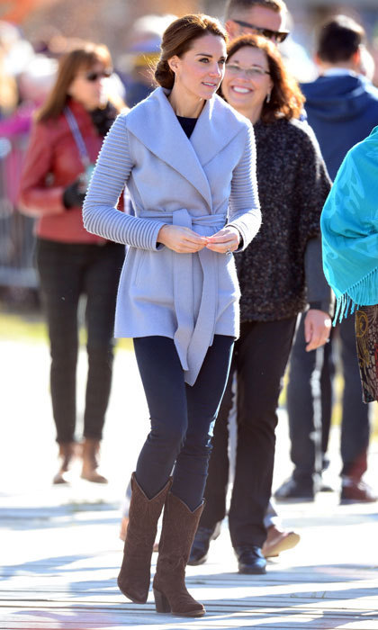 The Duchess was stylish for her 2016 visit to Canada's Carcross and Montana Mountain: a ribbed sweater wrap by Sentaler, which she paired with blue skinny jeans, brown suede cowboy boots and earrings by Yukon designer Shelley Macdonald.