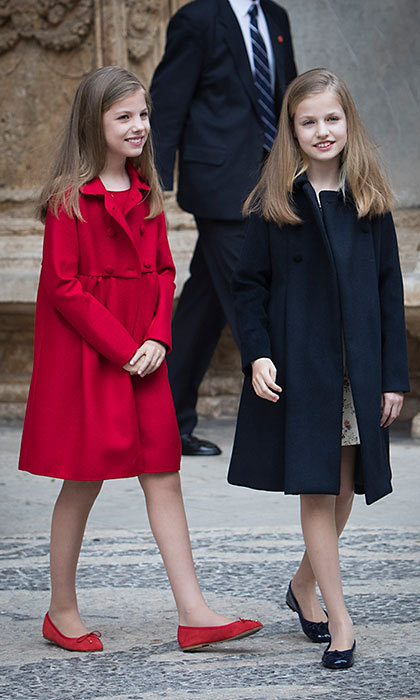 April 16: Queen Letizia's daughters Princess Leonor, in navy, and Princess Sofia, in red, perfectly complemented one another in tailored coats and ballet flats for Easter mass in Madrid. 