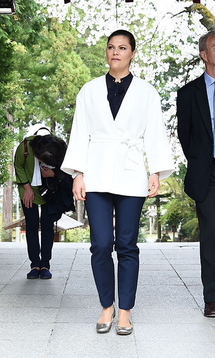 April 21: Crown Princess Victoria of Sweden visited Shiogama Shinto Shrine in Japan, wearing a kimono-style wrap jacket, and silver flats. 
