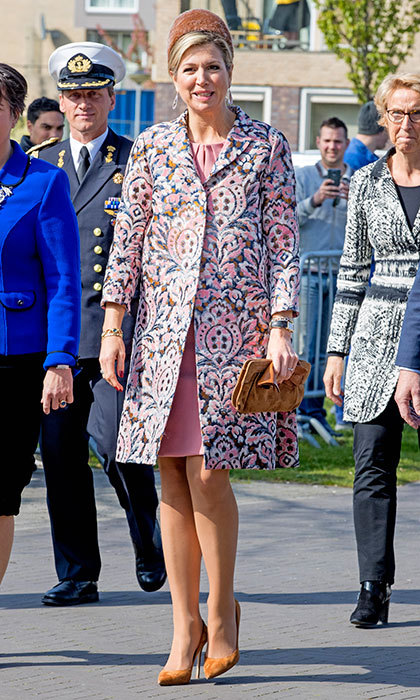 April 20: Queen Maxima of the Netherlands wore muted and matching accessories to play off her patterned pink coat for her visit to social restaurant Resto VanHarte.