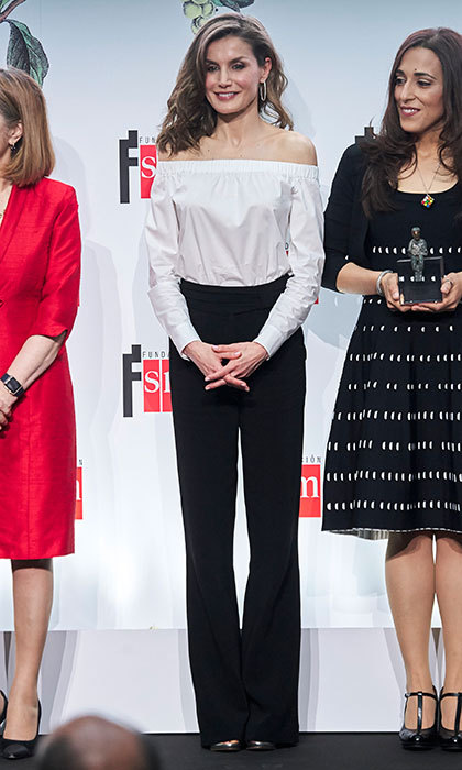 April 18: Queen Letizia of Spain opted for black and white again days earlier in a playful off-the-shoulder Hugo Boss top and black Uterque pants as she stepped out for a literature award engagement in Madrid.