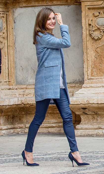 April 16: Queen Letizia does affordable fashion in style with a coat by Massimo Dutti coat teamed with a Hugo Boss blouse and blue leather pants for Sunday's Easter mass in Madrid.