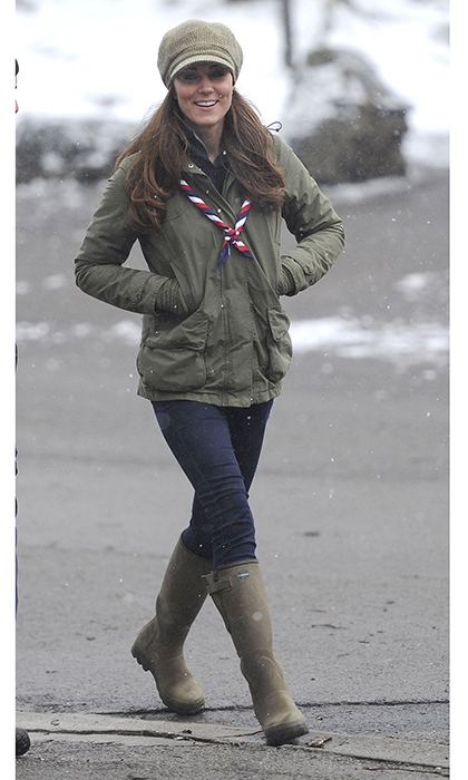Back in 2013, the Duchess of Cambridge visited the Great Tower Scouts in Windermere, Cumbria, United Kingdom. Her rainboots and knit cap outfit, perfect for the snowy weather, were accessorized with a scout scarf. 