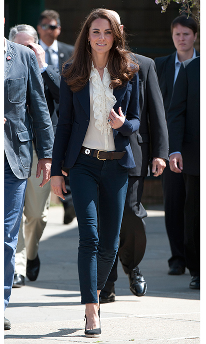 A ruffled blouse, blue blazer and wedge heels were a chic combo during a visit to Slave Lake, Alberta, during the royal tour of Canada in 2011. 
