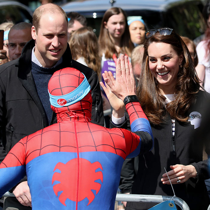 You're my superhero! Spiderman stops for no one – except the royals, of course. This runner took a moment to high five the Duchess mid-marathon.