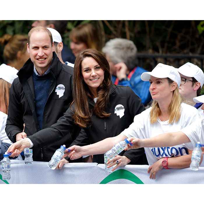 That water girl looks familiar! William stood next to the Duchess as she stood prepared with water for the runners.