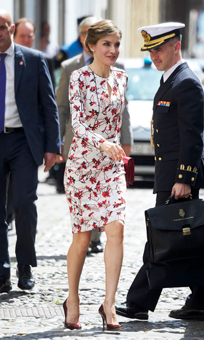 April 24: Queen Letizia pulled this Carolina Herrera floral number from her closet for a visit to Gran Canaria, Spain. The royal accessorized with a large red clutch bag and silver leaf Chanel earrings, along with a gorgeous pair of scarlet red heels by Marsala de Lodi.