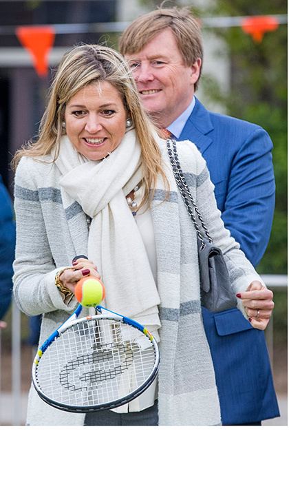 With husband King Willem-Alexander behind her, Queen Maxima of the Netherlands got a chance to show off her tennis skills on April 21. The royal couple were checking out the King's Games youth sport day at De Vijfmaster school in Veghel, Netherlands.