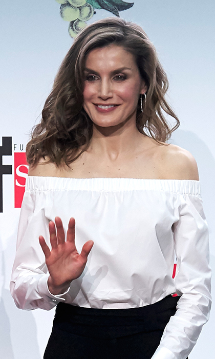 Queen Letizia of Spain looked ready for summer with glamorous waves and an off the shoulder top  at a literature awards ceremony held at Casa de Correos in Madrid on April 18.