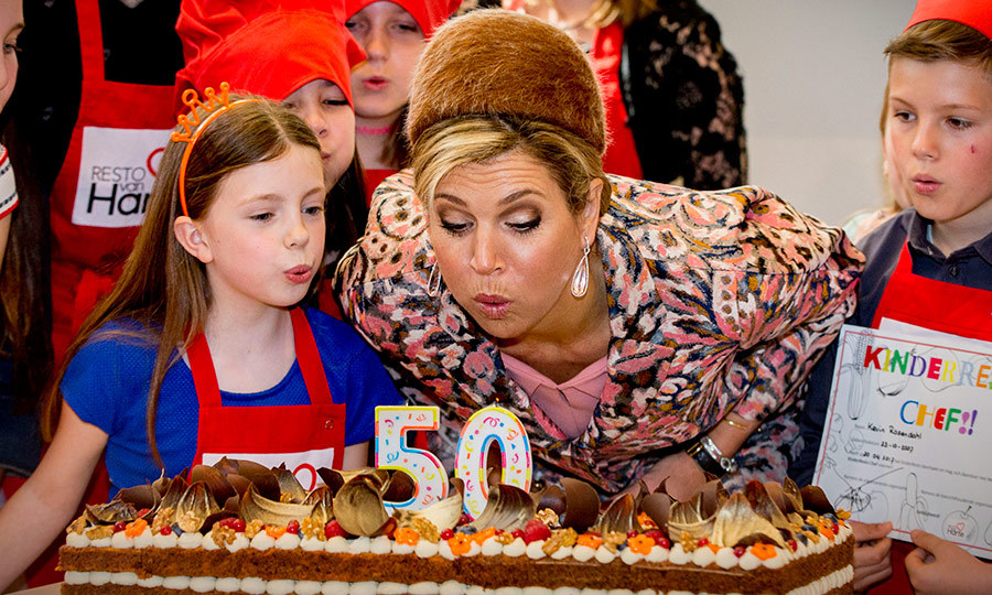 Make a wish! Queen Maxima of the Netherlands helped a young friend blow out some candles at social restaurant Resto VanHarte on April 20 in Lelystad, Netherlands.