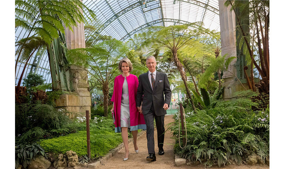 King Philippe and Queen Mathilde of Belgium took a stroll through the Royal Greenhouses of Laeken on April 20 in Brussels.